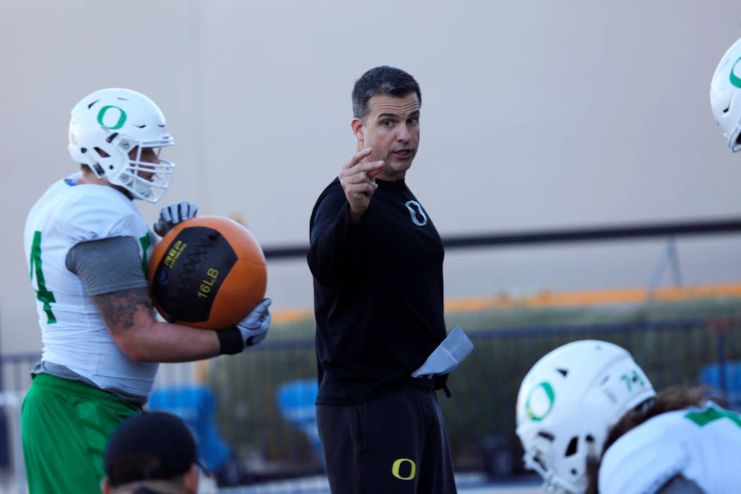 Oregon Ducks head coach Mario Cristobal during a football practice at Bishop Gorman High School in Las Vegas, Wednesday, Dec. 13, 2017. Oregon Ducks and Boise State Broncos will meet on Saturday,  ...