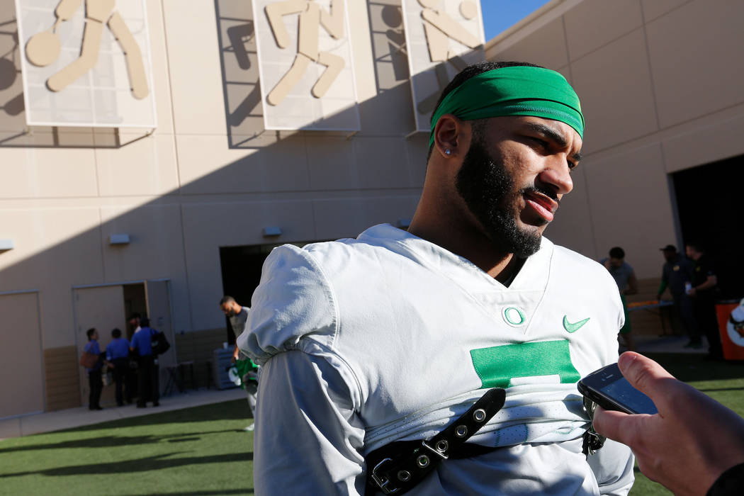 Oregon Ducks wide receiver Charles Nelson (6) speaks to reporter before a football practice at Bishop Gorman High School in Las Vegas, Wednesday, Dec. 13, 2017. Oregon Ducks and Boise State Bronco ...