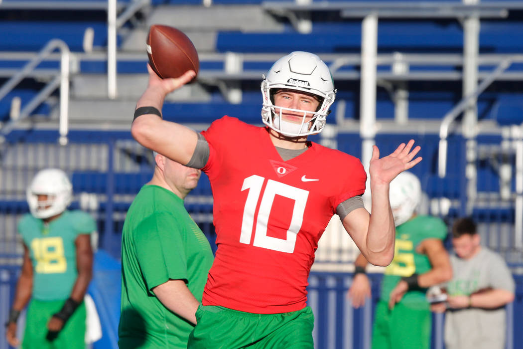 Oregon Ducks quarterback Justin Herbert (10) throws a ball during a football practice at Bishop Gorman High School in Las Vegas, Wednesday, Dec. 13, 2017. Oregon Ducks and Boise State Broncos will ...