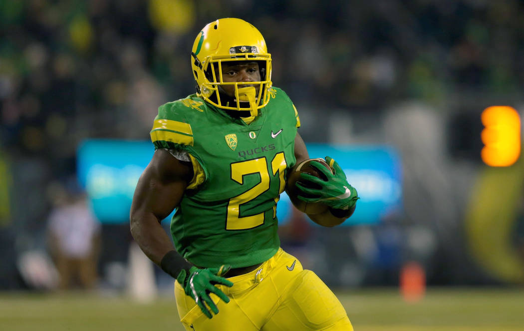Nov 18, 2017; Eugene, OR, USA; Oregon Ducks running back Royce Freeman (21) runs the ball in the fourth quarter against the Arizona Wildcats at Autzen Stadium. Mandatory Credit: Scott Olmos-USA TO ...