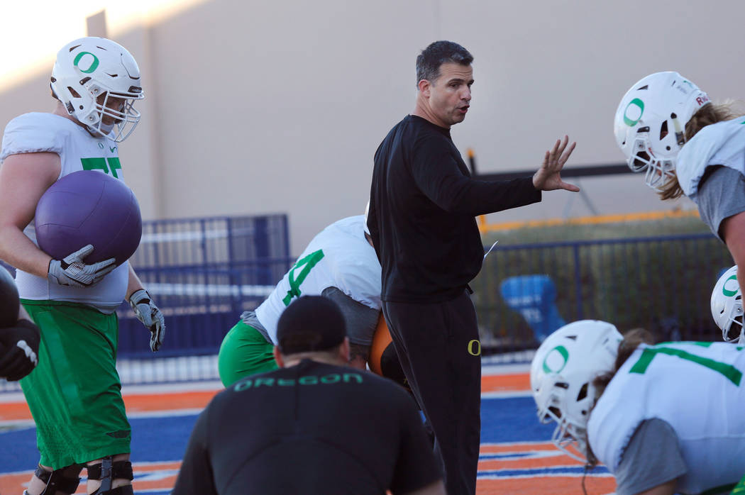 Oregon Ducks head coach Mario Cristobal during a football practice at Bishop Gorman High School in Las Vegas, Wednesday, Dec. 13, 2017. Oregon Ducks and Boise State Broncos will meet on Saturday,  ...