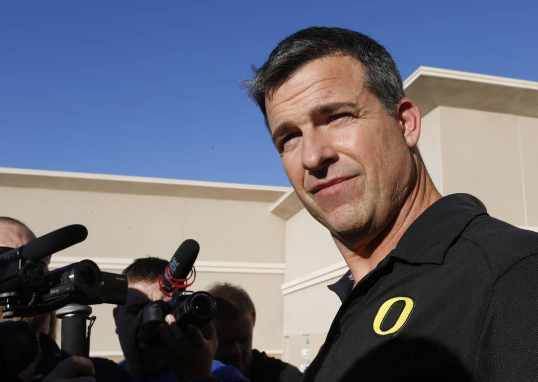 Oregon Ducks head coach Mario Cristobal pauses as speaking to reporters before a football practice at Bishop Gorman High School in Las Vegas, Thursday, Dec. 14, 2017. Oregon Ducks will meet Boise  ...