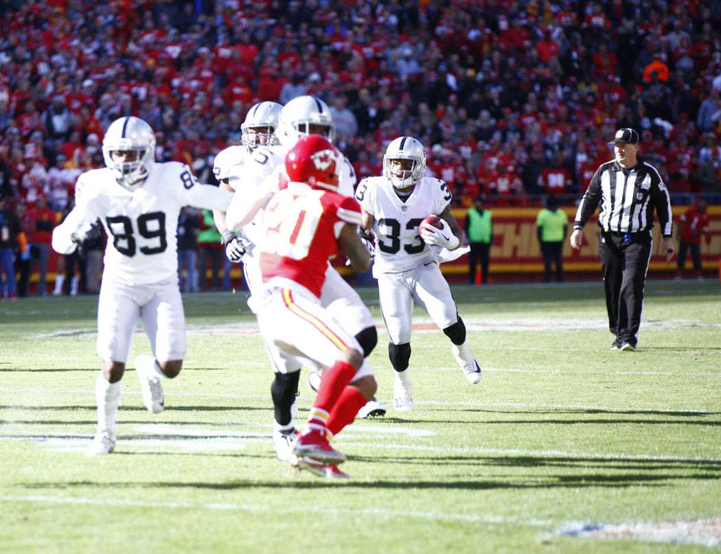 Oakland Raiders running back DeAndre Washington (33) runs with the football against the Kansas City Chiefs during the first half of a NFL game in Kansas City, Mo., Sunday, Dec. 10, 2017. Heidi Fan ...