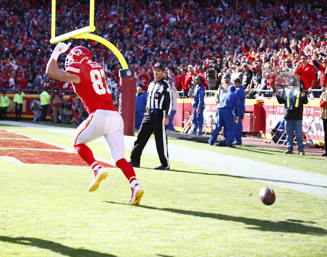 Kansas City Chiefs tight end Travis Kelce (87) celebrates his touchdown against the Oakland Raiders during the first half of a NFL game in Kansas City, Mo., Sunday, Dec. 10, 2017. Heidi Fang Las V ...