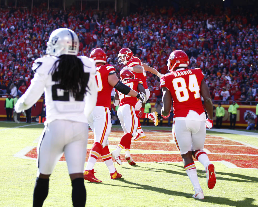 Kansas City Chiefs tight end Travis Kelce (87) celebrates his touchdown with running back Kareem Hunt (27) against the Oakland Raiders during the first half of a NFL game in Kansas City, Mo., Sund ...