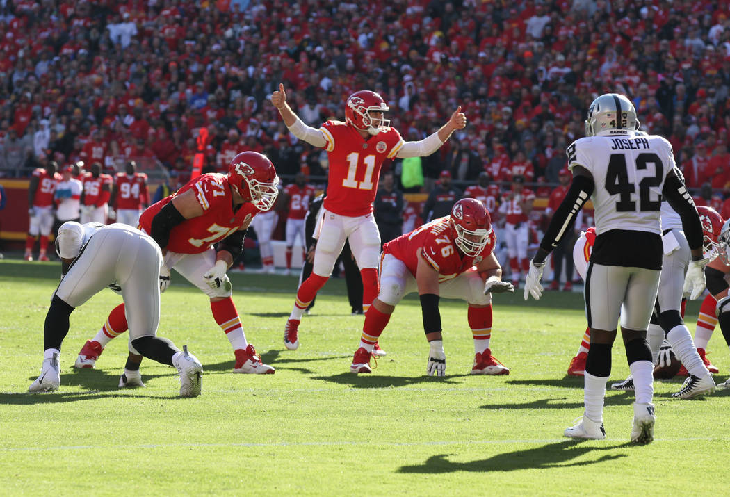 Kansas City Chiefs quarterback Alex Smith (11) calls a play at the line of scrimmage against the Oakland Raiders during the first half of a NFL game in Kansas City, Mo., Sunday, Dec. 10, 2017. Hei ...