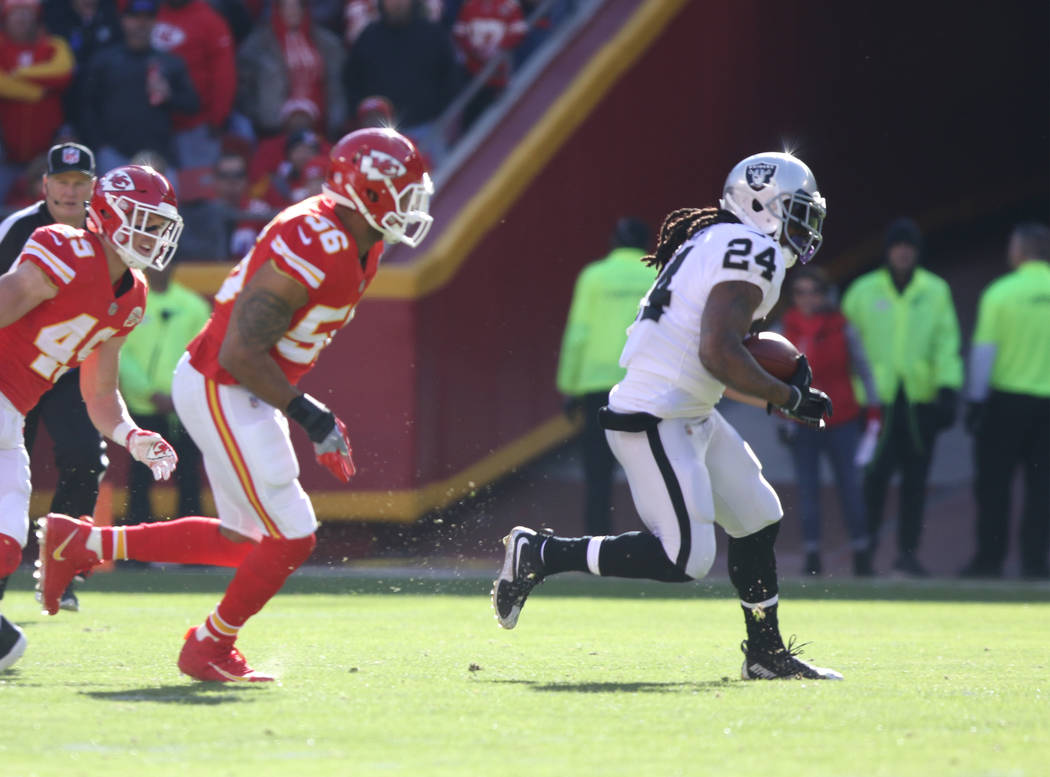 Oakland Raiders running back Marshawn Lynch (24) runs with the football as Kansas City Chiefs inside linebacker Derrick Johnson (56) pursues him during the first half of a NFL game in Kansas City, ...