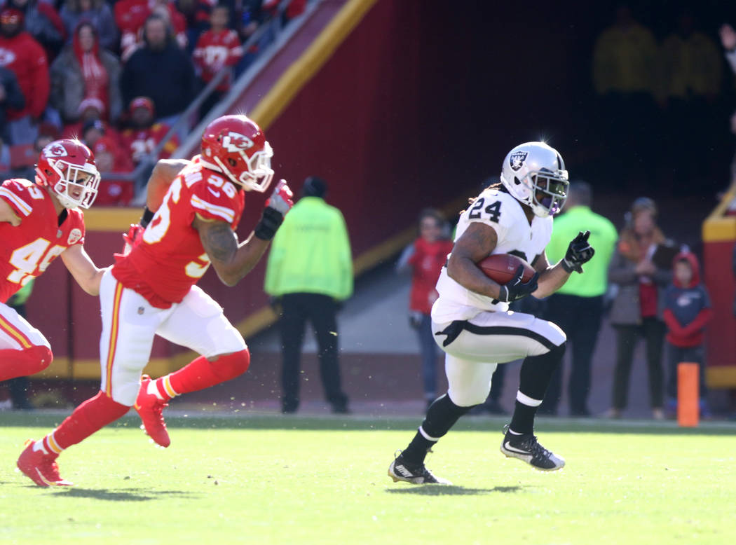 Oakland Raiders running back Marshawn Lynch (24) runs with the football as Kansas City Chiefs inside linebacker Derrick Johnson (56) and Kansas City Chiefs strong safety Daniel Sorensen (49) pursu ...