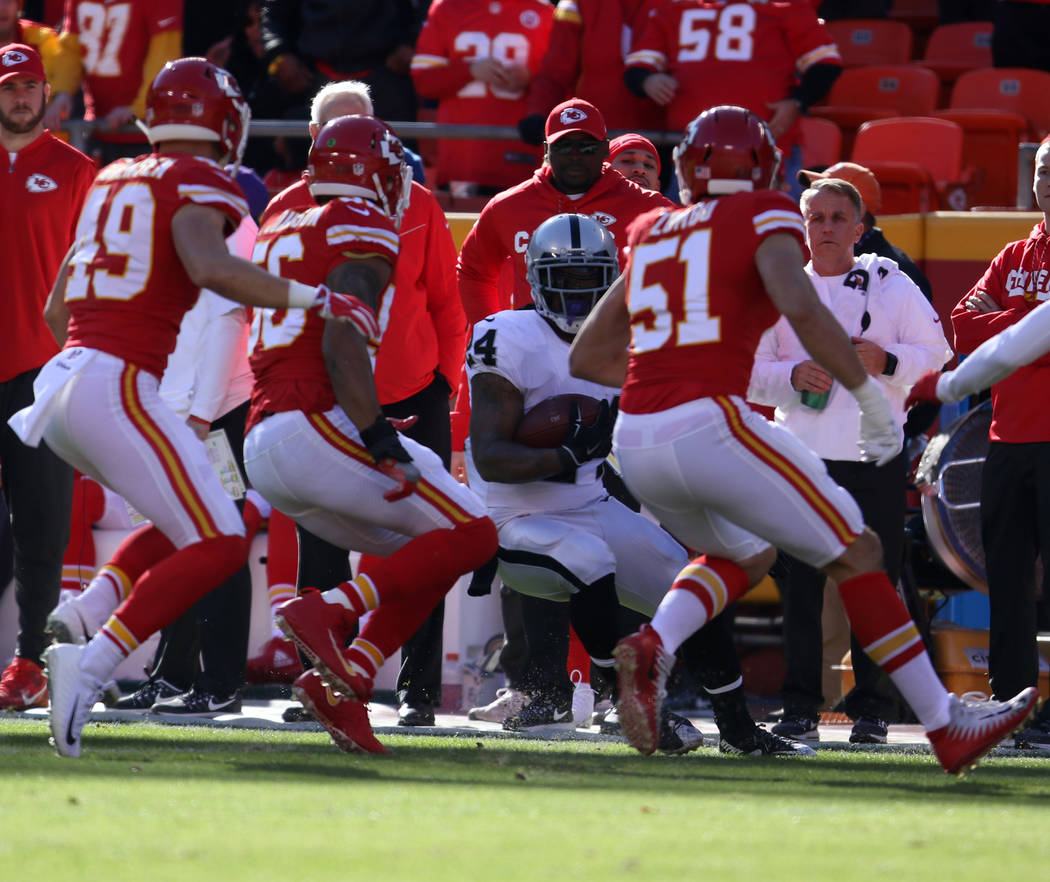 Oakland Raiders running back Marshawn Lynch (24) is forced out of bounds by Kansas City Chiefs inside linebacker Derrick Johnson (56), strong safety Daniel Sorensen (49) and outside linebacker Fra ...