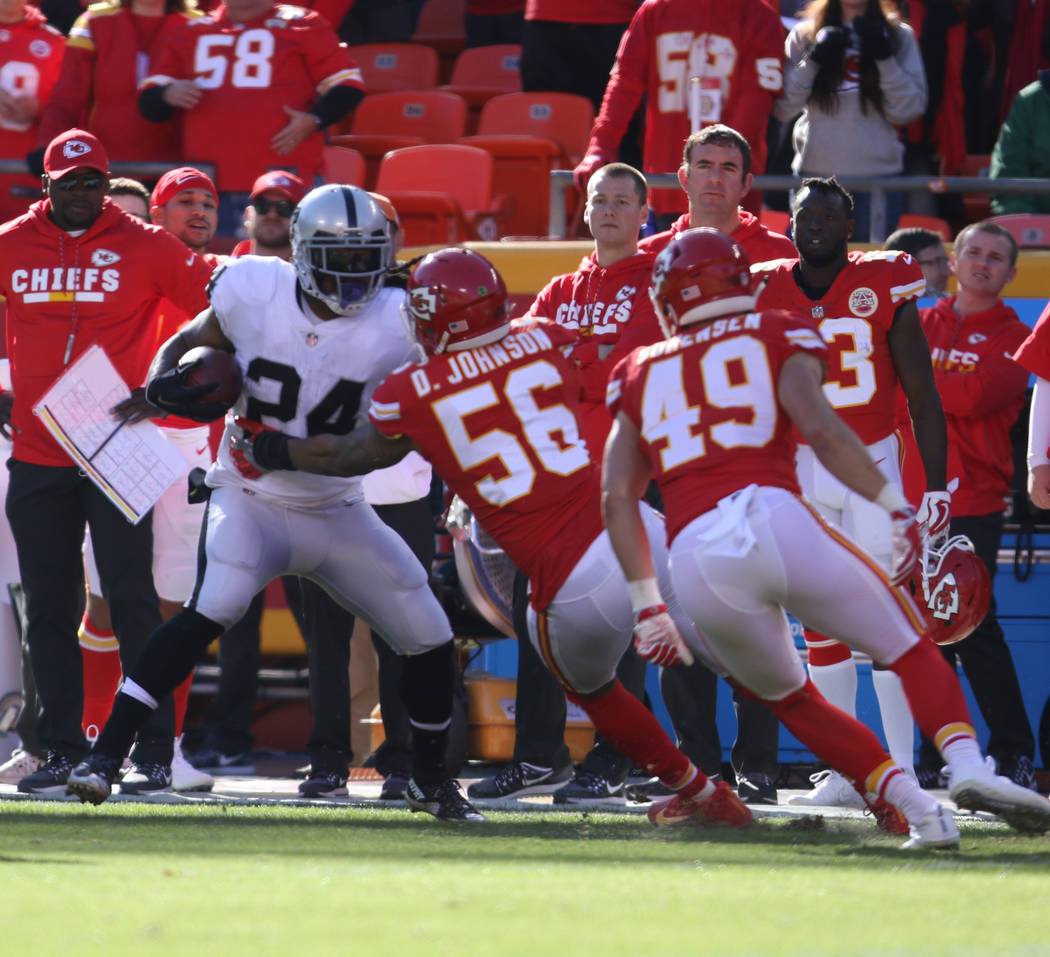 Oakland Raiders running back Marshawn Lynch (24) is forced out of bounds by Kansas City Chiefs inside linebacker Derrick Johnson (56), strong safety Daniel Sorensen (49) during the first half of a ...