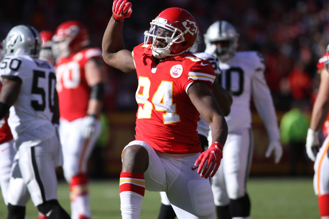 Kansas City Chiefs tight end Demetrius Harris (84) celebrates catching a first down pass against the Oakland Raiders during the first half of a NFL game in Kansas City, Mo., Sunday, Dec. 10, 2017. ...