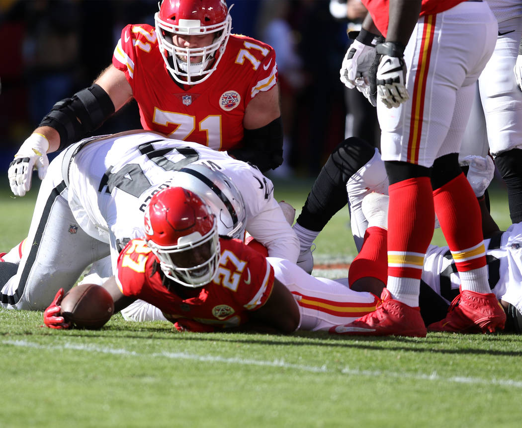 Kansas City Chiefs running back Kareem Hunt (27) after being tackled by the Oakland Raiders during the first half of a NFL game in Kansas City, Mo., Sunday, Dec. 10, 2017. Heidi Fang Las Vegas Rev ...