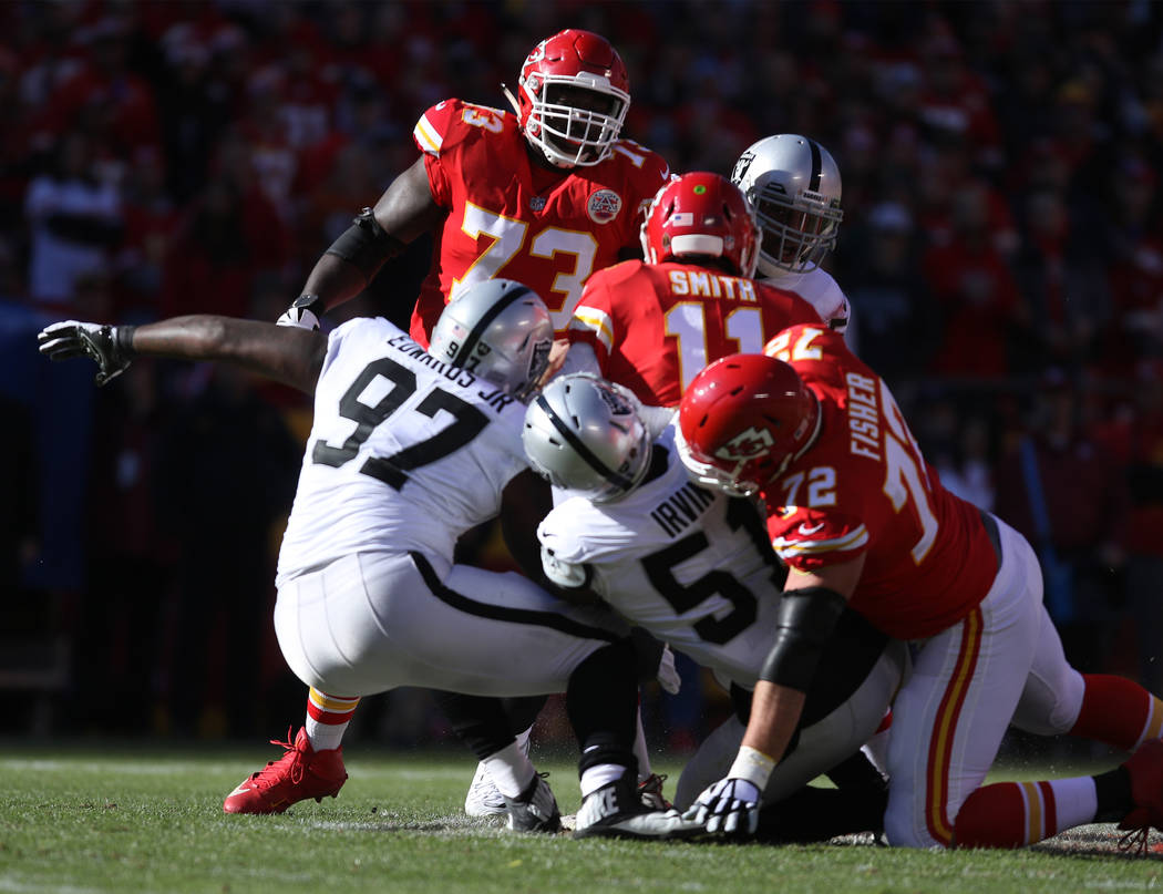 Kansas City Chiefs quarterback Alex Smith (11) is sacked by Oakland Raiders outside linebacker Bruce Irvin (51) during the first half of a NFL game in Kansas City, Mo., Sunday, Dec. 10, 2017. Heid ...