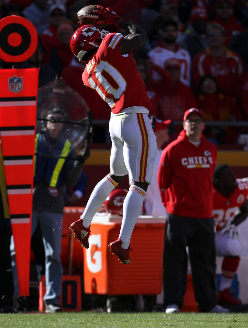 Kansas City Chiefs wide receiver Tyreek Hill (10) leaps to catch the football against the Oakland Raiders during the first half of a NFL game in Kansas City, Mo., Sunday, Dec. 10, 2017. Heidi Fang ...