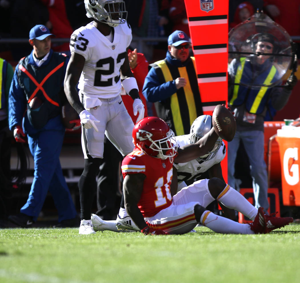 Kansas City Chiefs wide receiver Tyreek Hill (10) after making a catch and being tackled by Oakland Raiders cornerback Dexter McDonald (23) during the first half of a NFL game in Kansas City, Mo., ...