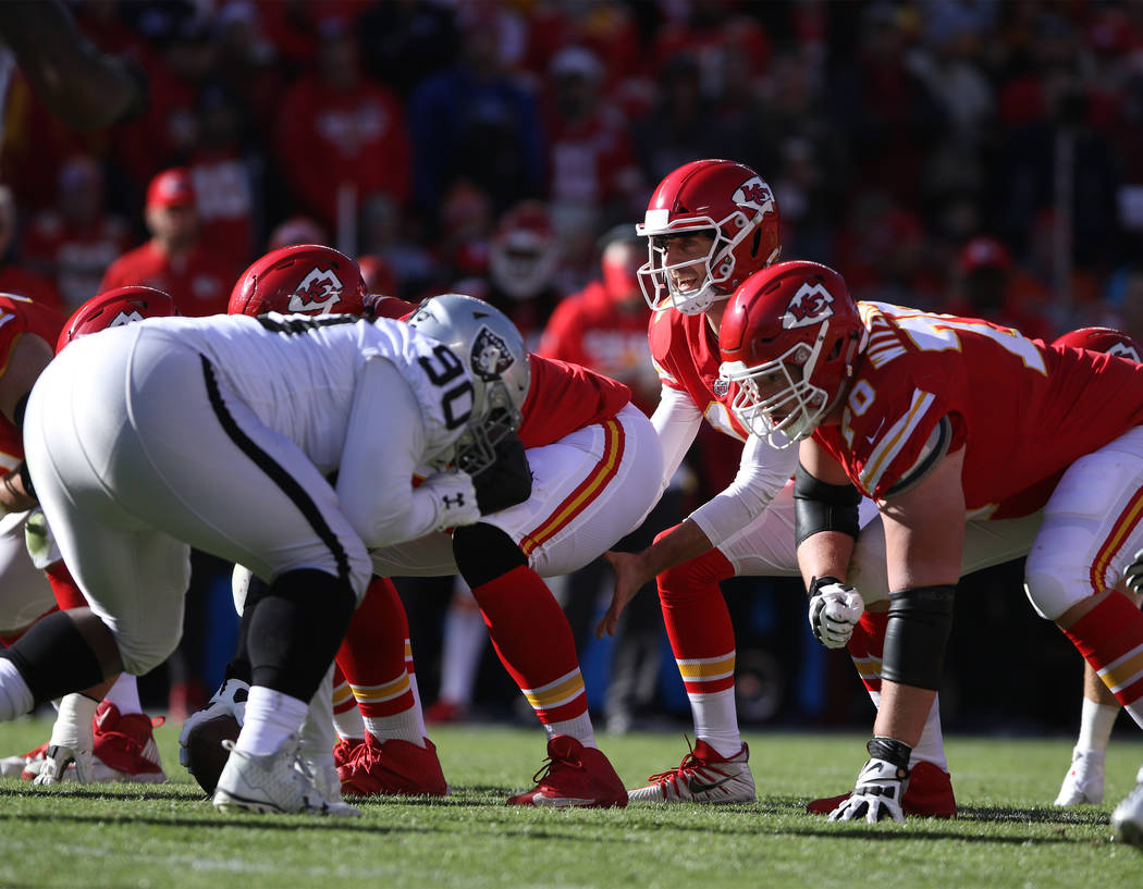 Kansas City Chiefs quarterback Alex Smith (11) at the line of scrimmage against the Oakland Raiders during the first half of a NFL game in Kansas City, Mo., Sunday, Dec. 10, 2017. Heidi Fang Las V ...