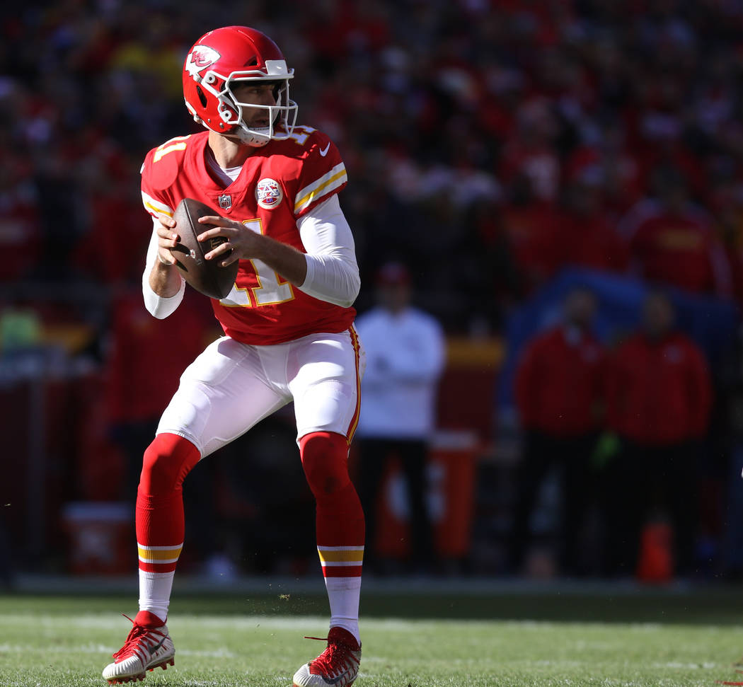 Kansas City Chiefs quarterback Alex Smith (11) prepares to throw the football during the first half of a NFL game against the Oakland Raiders in Kansas City, Mo., Sunday, Dec. 10, 2017. Heidi Fang ...