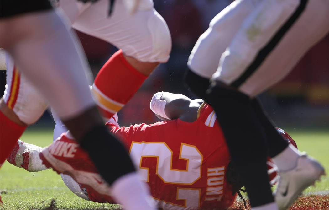 Kansas City Chiefs running back Kareem Hunt (27) dives into the end zone for a touchdown against the Oakland Raiders during the first half of a NFL game in Kansas City, Mo., Sunday, Dec. 10, 2017. ...