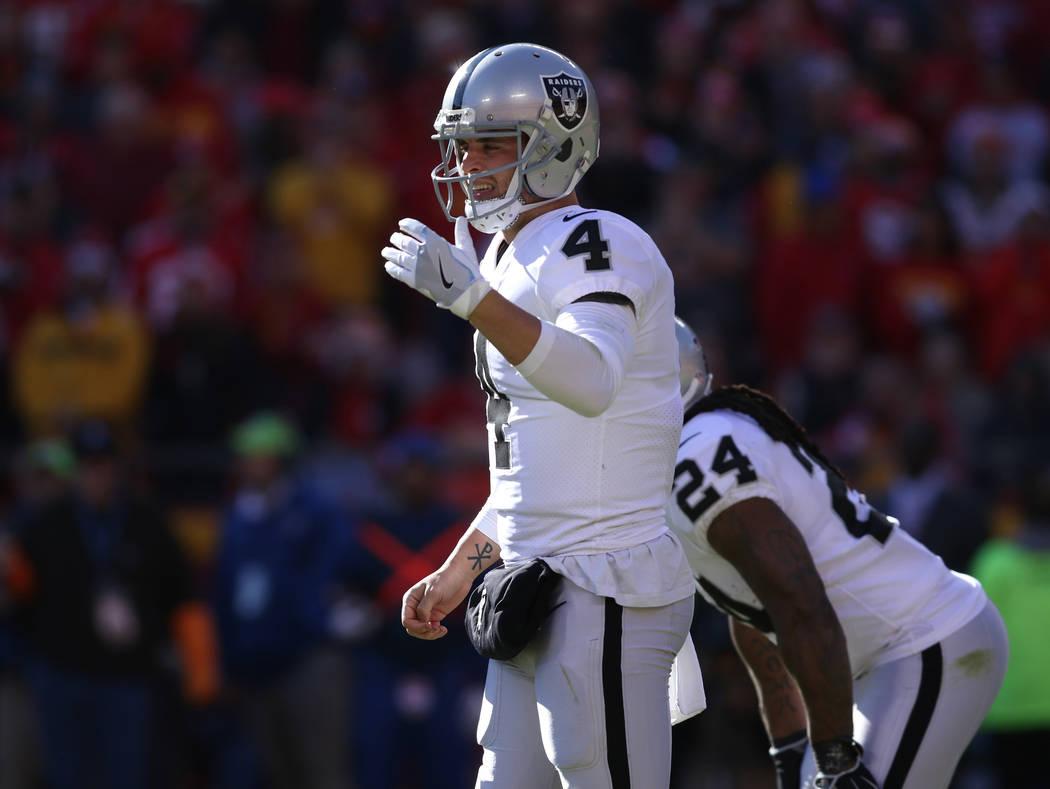 Oakland Raiders quarterback Derek Carr (4) calls a play against the Kansas City Chiefs during the first half of a NFL game in Kansas City, Mo., Sunday, Dec. 10, 2017. Heidi Fang Las Vegas Review-J ...