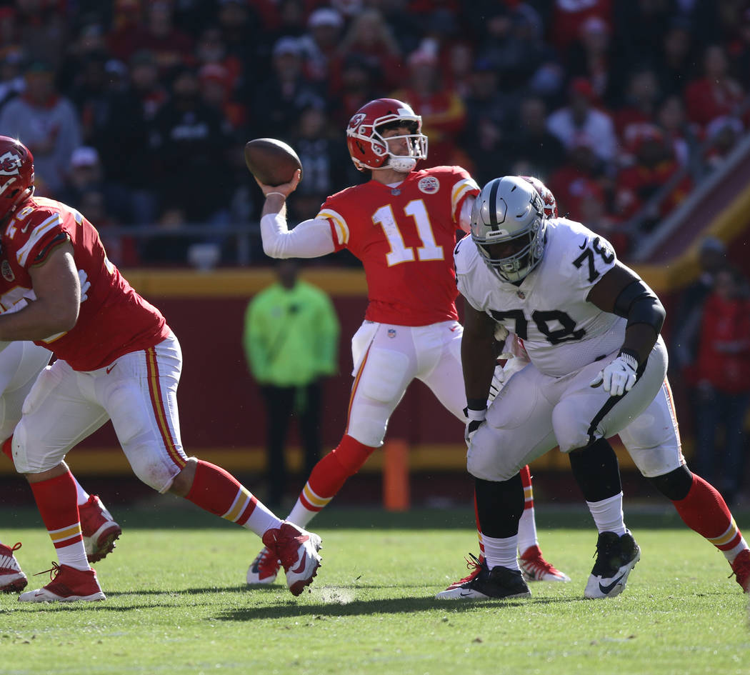 Kansas City Chiefs quarterback Alex Smith (11) throws the football against the Oakland Raiders during the first half of a NFL game in Kansas City, Mo., Sunday, Dec. 10, 2017. Heidi Fang Las Vegas  ...