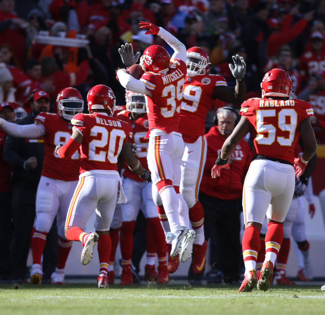 Kansas City Chiefs cornerback Terrance Mitchell (39) celebrates his intercepted pass thrown by Oakland Raiders quarterback Derek Carr (4), not pictured, with strong safety Eric Berry (29) during t ...