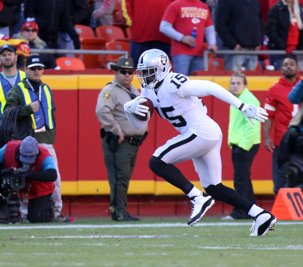 Oakland Raiders wide receiver Michael Crabtree (15) catches a pass against the Kansas City Chiefs during the first half of a NFL game in Kansas City, Mo., Sunday, Dec. 10, 2017. Heidi Fang Las Veg ...
