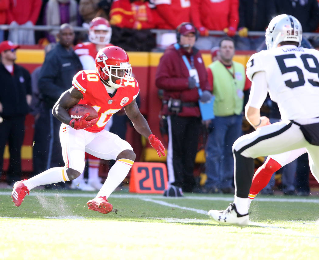 Kansas City Chiefs wide receiver Tyreek Hill (10) returns a punt against the Oakland Raiders during the first half of a NFL game in Kansas City, Mo., Sunday, Dec. 10, 2017. Heidi Fang Las Vegas Re ...