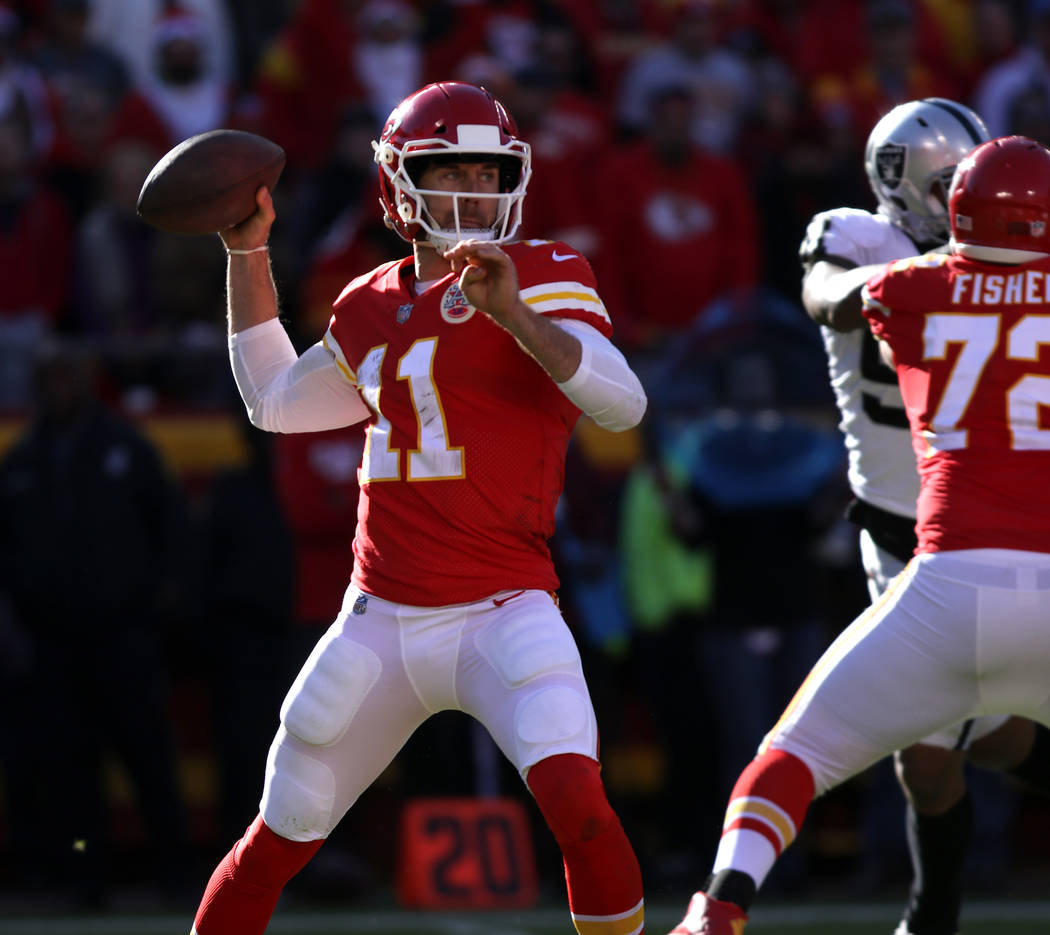 Kansas City Chiefs quarterback Alex Smith (11) prepares to throw the football against the Oakland Raiders during the first half of a NFL game in Kansas City, Mo., Sunday, Dec. 10, 2017. Heidi Fang ...