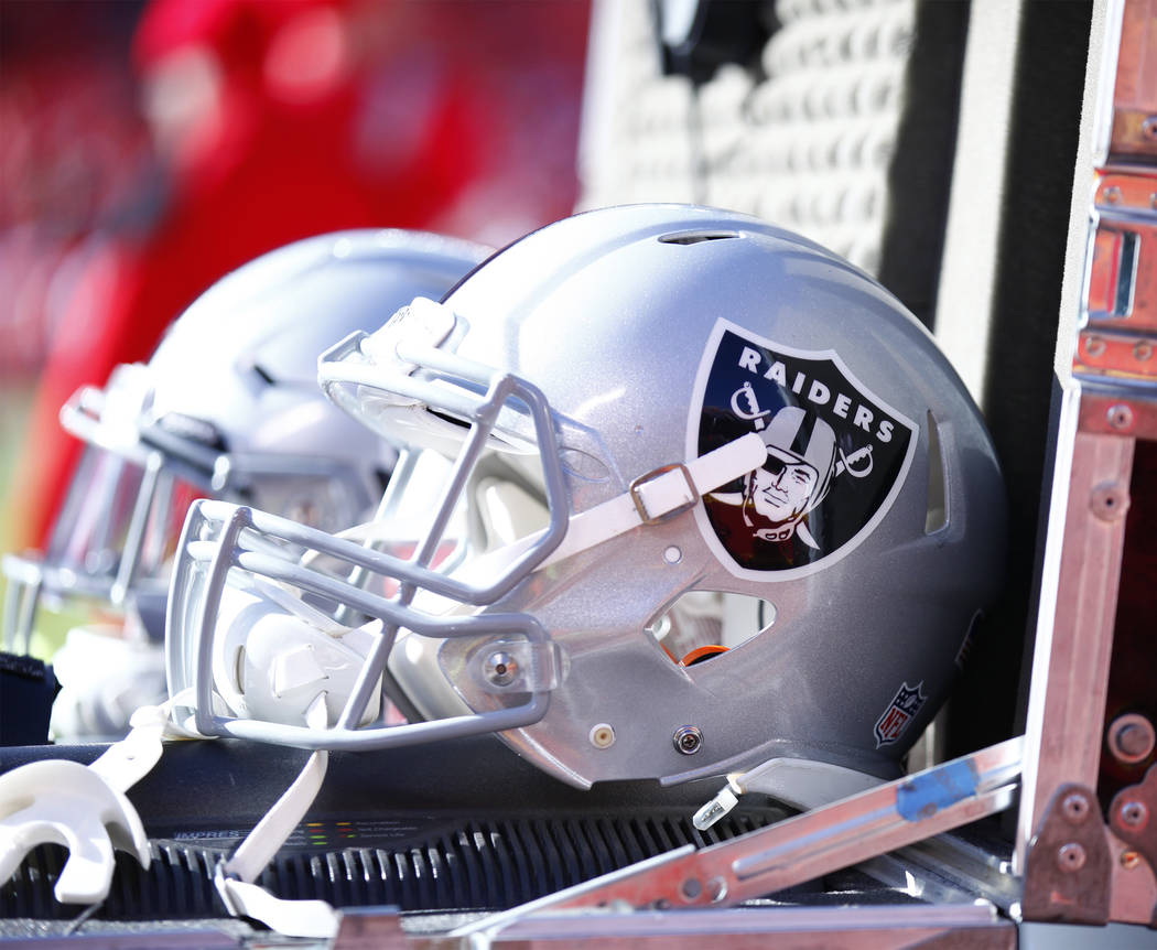 The Oakland Raiders helmets lay in an equipment box on the team's sideline during the first half of a NFL game against the Kansas City Chiefs in Kansas City, Mo., Sunday, Dec. 10, 2017. Heidi Fang ...