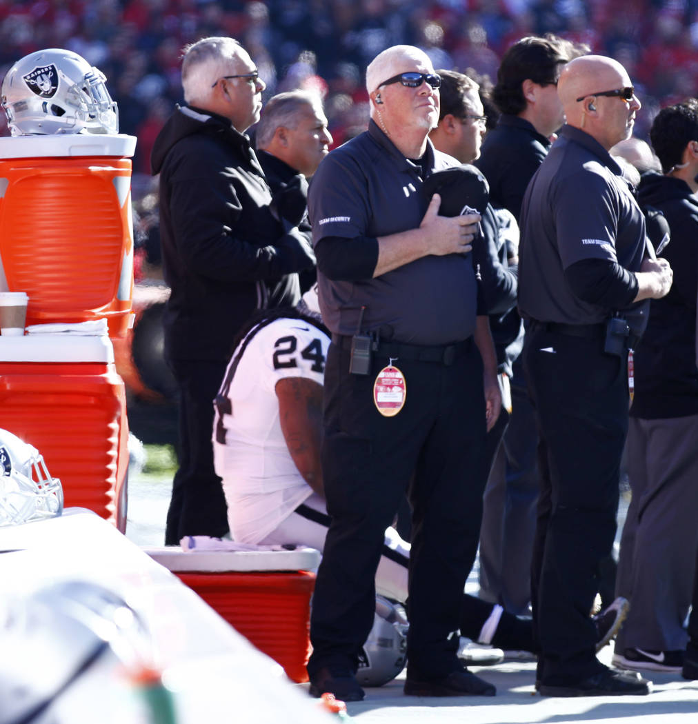 Oakland Raiders running back Marshawn Lynch (24) sits on a cooler during the national anthem prior to the start of the team's game against the Kansas City Chiefs in Kansas City, Mo., Sunday, Dec.  ...