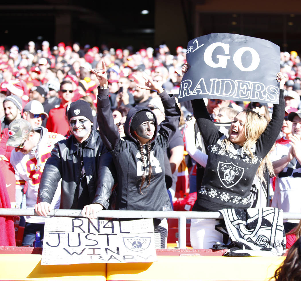 Oakland Raiders fans cheer for their team in Arrowhead Stadium during the first half of a NFL game against the Kansas City Chiefs in Kansas City, Mo., Sunday, Dec. 10, 2017. Heidi Fang Las Vegas R ...