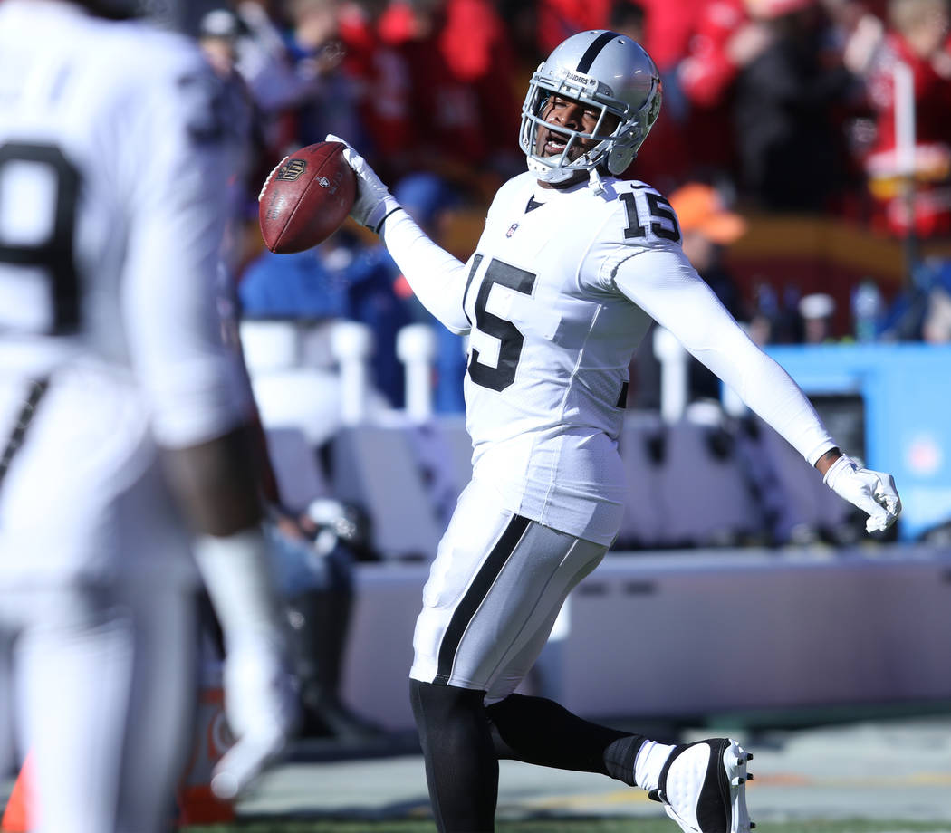 Oakland Raiders wide receiver Michael Crabtree (15) catches a pass during warm ups ahead of the team's game against the Kansas City Chiefs in Kansas City, Mo., Sunday, Dec. 10, 2017. Heidi Fang La ...