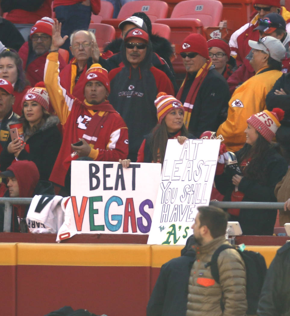 Kansas City Chiefs fans hold up signs on the Oakland Raiders move to Las Vegas prior to the start of a NFL game in Kansas City, Mo., Sunday, Dec. 10, 2017. Heidi Fang Las Vegas Review-Journal @Hei ...