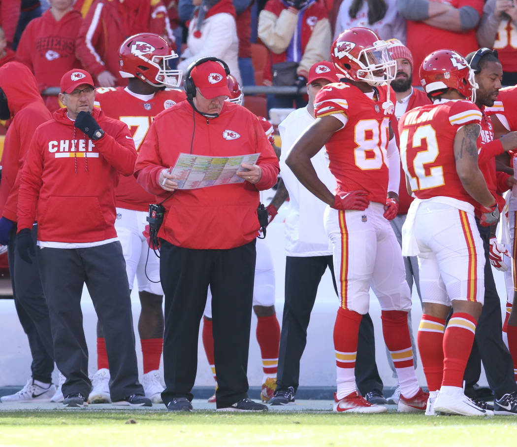 Kansas City Chiefs head coach Andy Reid looks over his play calling sheet during the first half of a NFL game against the Oakland Raiders in Kansas City, Mo., Sunday, Dec. 10, 2017. Heidi Fang Las ...