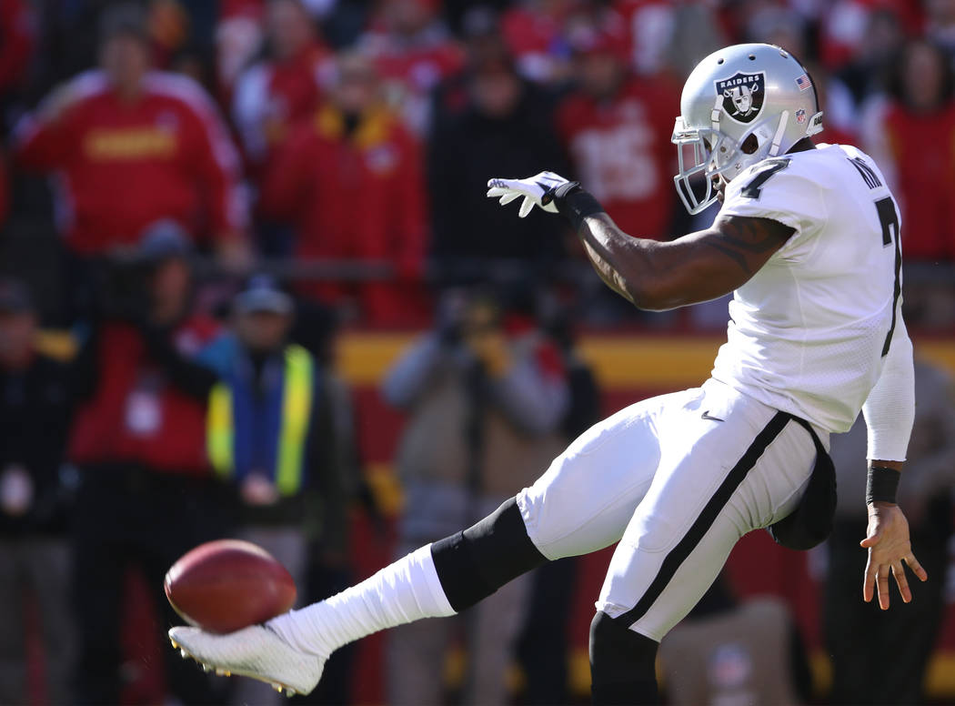 Oakland Raiders punter Marquette King (7) punts the football during the first half of a NFL game against the Kansas City Chiefs in Kansas City, Mo., Sunday, Dec. 10, 2017. Heidi Fang Las Vegas Rev ...