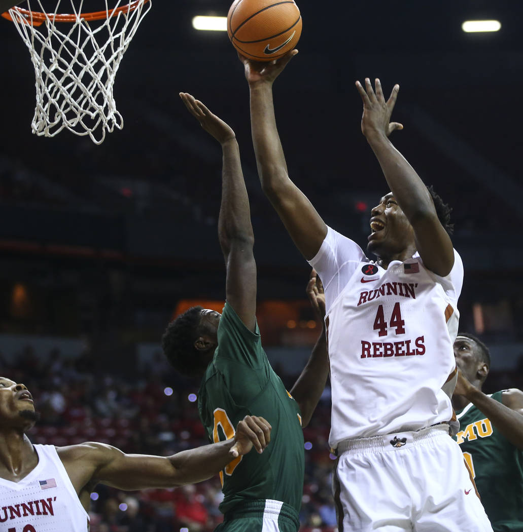 UNLV's Brandon McCoy (44) goes to the basket over Florida A&M's Rashad Austin (30) during their basketball game at the Thomas & Mack Center in Las Vegas on Saturday, Nov. 11, 2017. Chase S ...