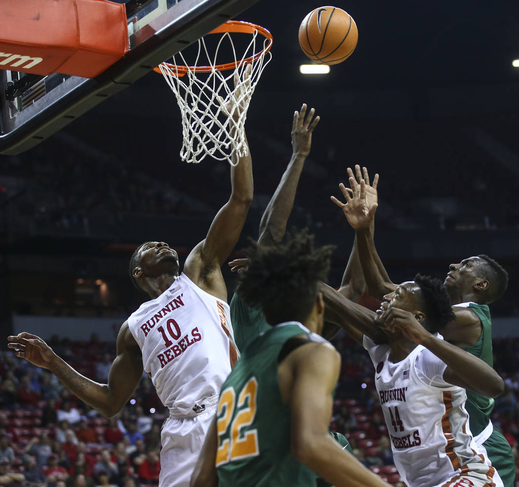 UNLV's Shakur Juiston (10) and Brandon McCoy (44) go up for a rebound against Florida A&M during their basketball game at the Thomas & Mack Center in Las Vegas on Saturday, Nov. 11, 2017.  ...