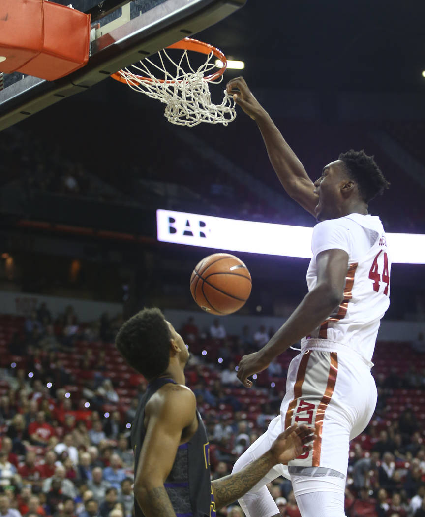 UNLV's Brandon McCoy (44) dunks over Prairie View A&M's Gary Blackston (3) during their basketball game at Thomas & Mack Center in Las Vegas on Wednesday, Nov. 15, 2017. Chase Stevens Las  ...