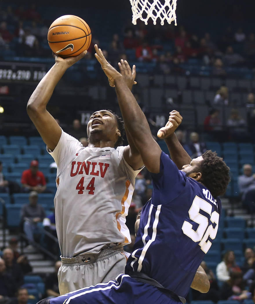 Oral Roberts' Chris Miller (52) defends as UNLV's Brandon McCoy (44) goes to the basket during their basketball game at the MGM Grand Garden Arena in Las Vegas on Tuesday, Dec. 5, 2017. Chase Stev ...