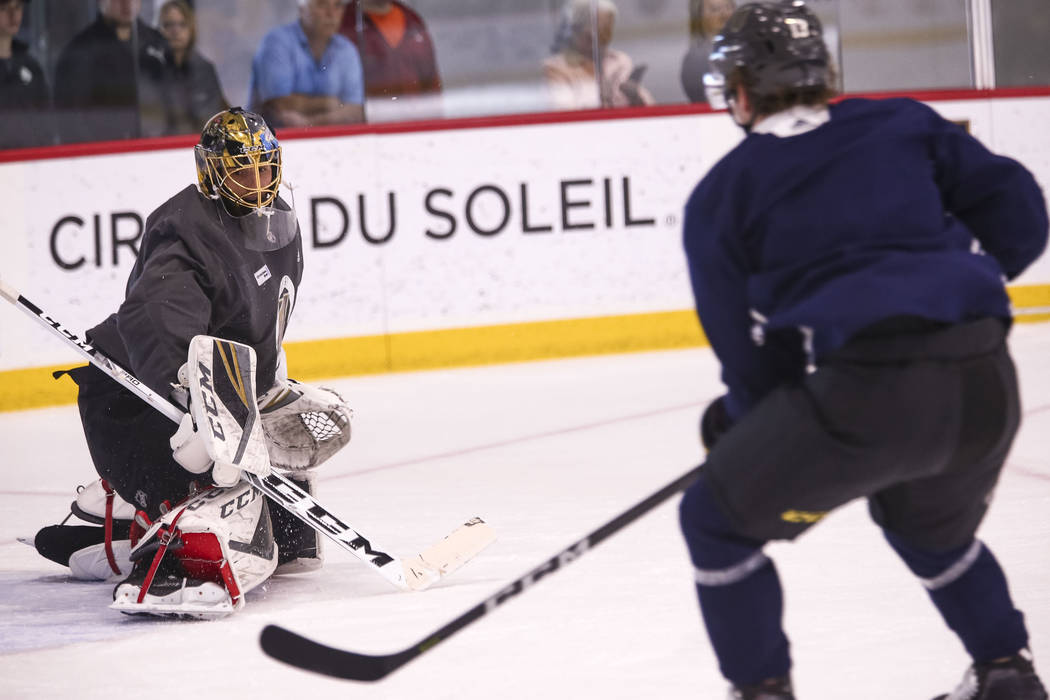 Vegas Golden Knights goalie Marc-Andre Fleury, left, and left wing Brendan Leipsic (13) on the ice during the NHL team's practice at the City National Arena in Las Vegas, Wednesday, Dec. 6, 2017.  ...