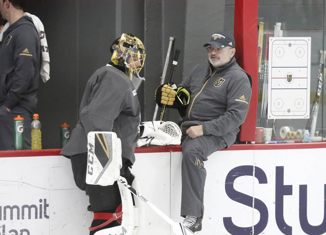 Vegas Golden Knights goalie Marc-Andre Fleury chats with goalie coach David Prior during team's practice on Monday, Dec. 11, 2017, in Las Vegas. Bizuayehu Tesfaye Las Vegas Review-Journal @bizutesfaye