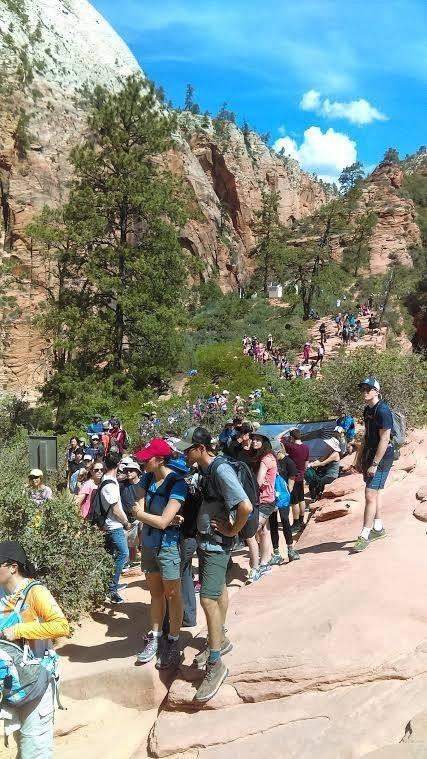 In this May 28, 2016 photo, provided by Zion National Park people line up at Angels Landing in Zion National Park, Utah. The sweeping red-rock vistas at Zion National Park are increasingly filled  ...