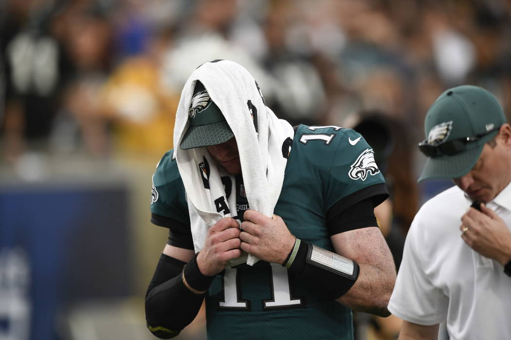 Philadelphia Eagles quarterback Carson Wentz leaves the field during the second half of an NFL football game against the Los Angeles Rams Sunday, Dec. 10, 2017, in Los Angeles. (AP Photo/Kelvin Kuo)