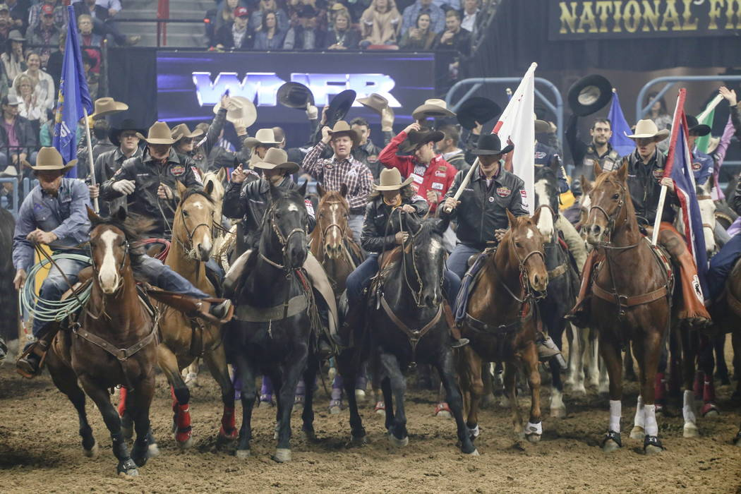 Riders enter the arena at the start of the fourth night of the 59th Wrangler National Finals Rodeo at the Thomas & Mack Center in Las Vegas, Sunday, Dec. 10, 2017. Joel Angel Juarez Las Vegas  ...
