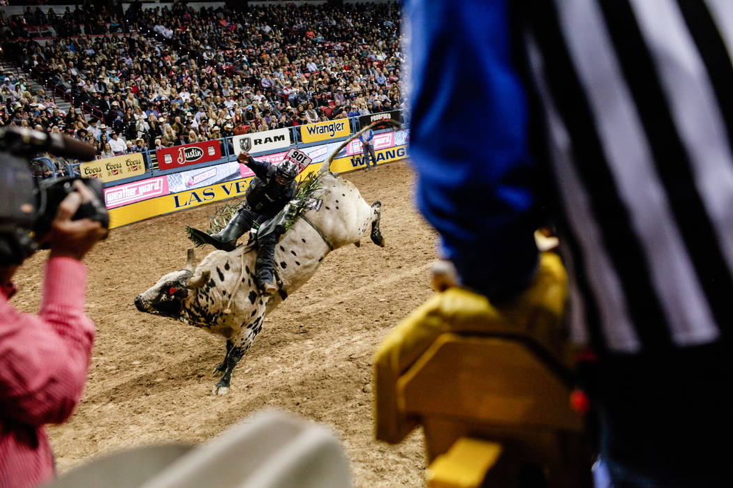 Jordan Hansen of Okotoks, Alberta rides 100X Helmet's Boothill in the bull riding event during the fourth night of the 59th Wrangler National Finals Rodeo at the Thomas & Mack Center in Las Ve ...