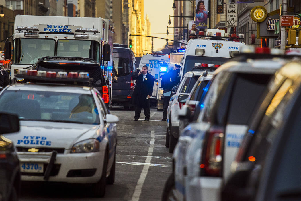 Police block a street by Port Authority Bus Terminal near New York's Times Square following an explosion on Monday, Dec. 11, 2017. Police say the explosion happened in an underground passageway  ...