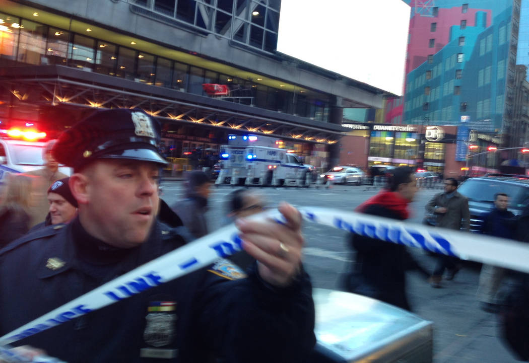 New York police respond to a report of an explosion near Times Square on Monday, Dec. 11, 2017, in New York. (Charles Zoeller/AP)