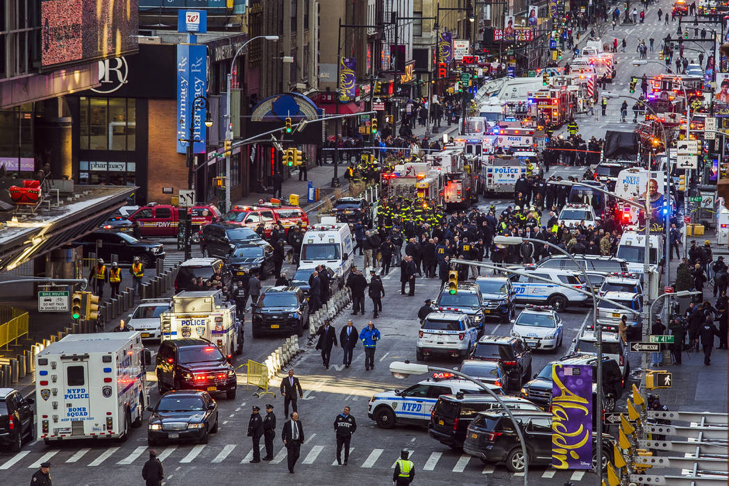 Law enforcement officials work following an explosion near New York's Times Square on Monday, Dec. 11, 2017. Police said a man with a pipe bomb strapped to his body set off the crude device in a p ...