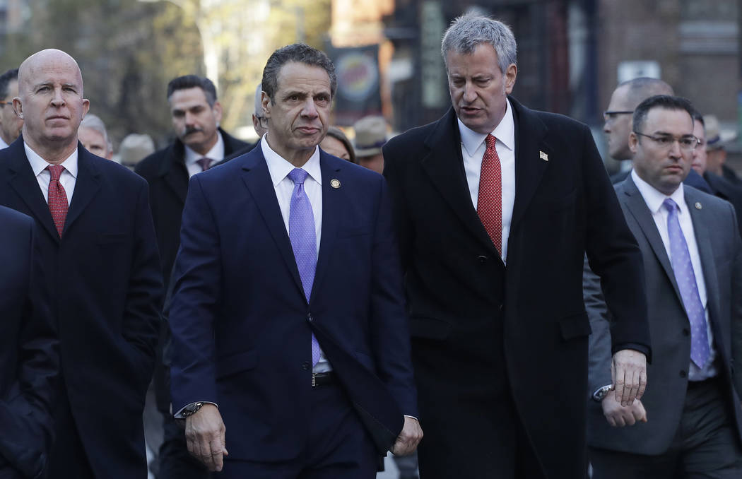 New York Gov. Andrew Cuomo, center, and Mayor Bill de Blasio arrive for a news conference, Monday, Dec. 11, 2017, outside the Port Authority Bus Terminal in New York. Police said a man with a pipe ...