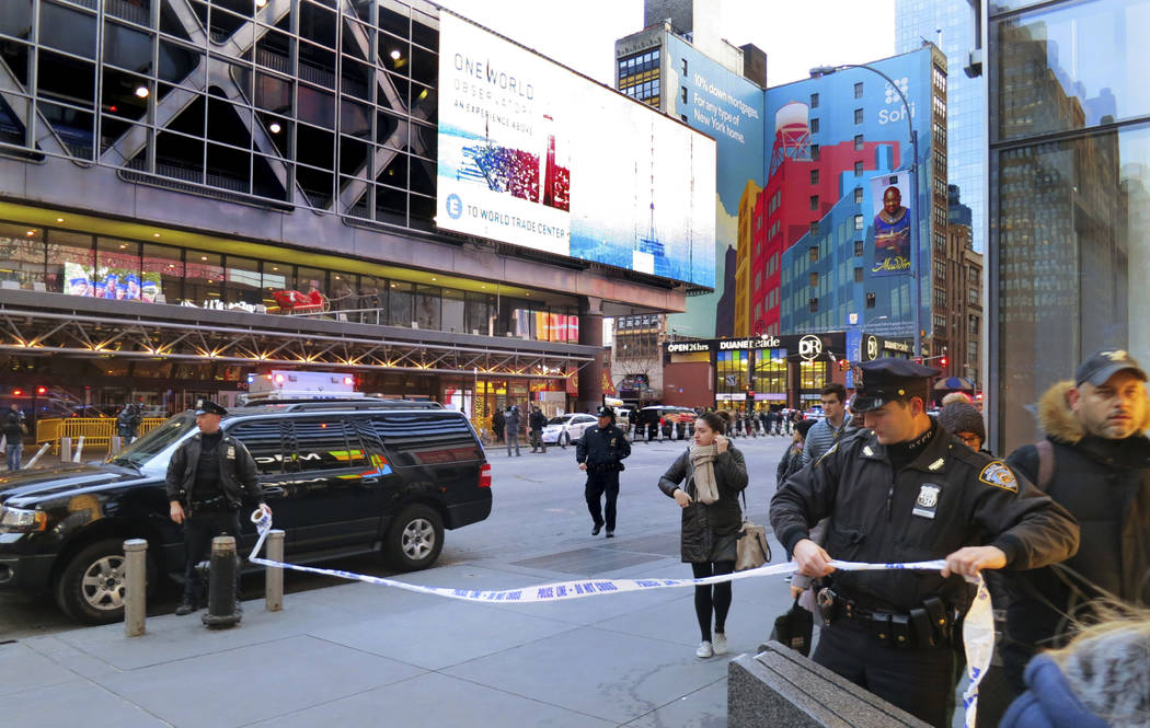 Police secure Eighth Avenue outside the Port Authority Bus Terminal following an explosion near New York's Times Square on Monday, Dec. 11, 2017. Police said a man with a pipe bomb strapped to him ...